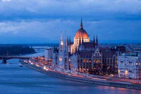 Budapest. Hungarian parliament in Budapest during twilight blue hour. photo