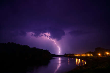 electric storm: clouds and thunder lightnings and storm in river Tisza. Hungary