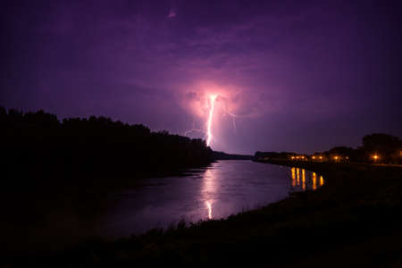 lightnings: clouds and thunder lightnings and storm in river Tisza. Hungary