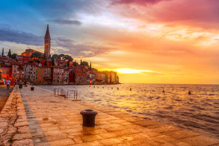 pier: Beautiful sunset at Rovinj in Adriatic sea coast of Croatia Stock Photo