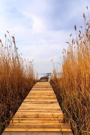 Wooden pier in tranquil lake Balaton-Hungary