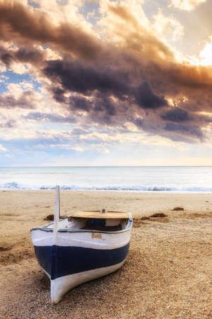 gusty: Boat on the beach near Almeria at sunset time. Cabo de Gata Nijar Natural Park, Almería. Spain. Andalusia