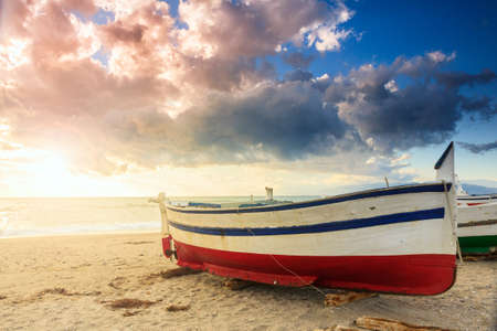 gusty: Boat on the beach near Almeria at sunset time. Stock Photo