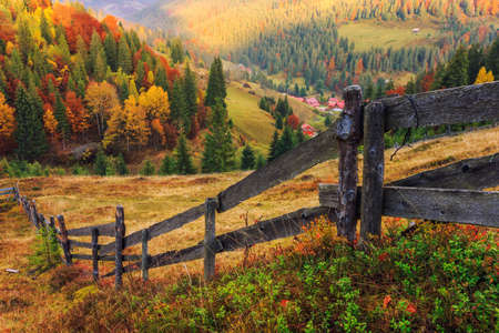 autumn sky: Colorful autumn landscape scene with fence in Transylvania mountain-Romania