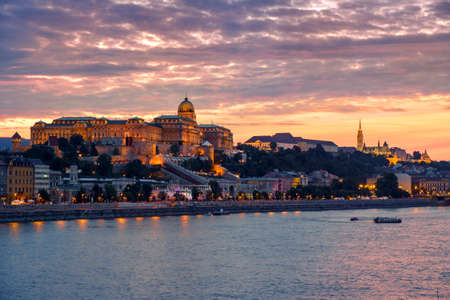 river stones: Budapest Castle at Sunset from danube river, Hungary