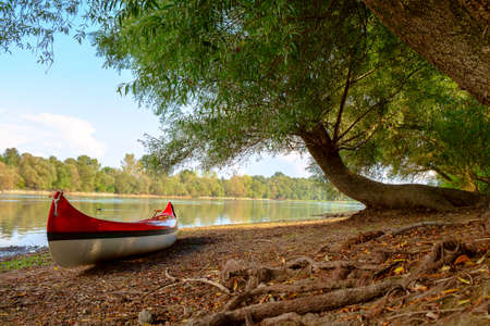 canoeing: Red canoe on beach at river Danube, Hungary Stock Photo