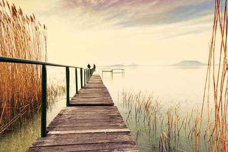 lake beach: Wooden pier in tranquil lake Balaton-Hungary