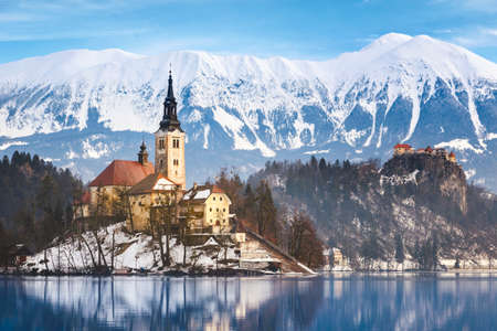 europe: Lake Bled with St. Marys Church of the Assumption on the small island; Bled, Slovenia, Europe. Stock Photo
