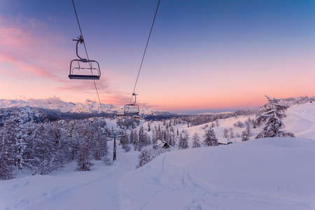 wintersport: Winter mountains panorama with ski slopes and ski lifts near Vogel ski center, Slovenia