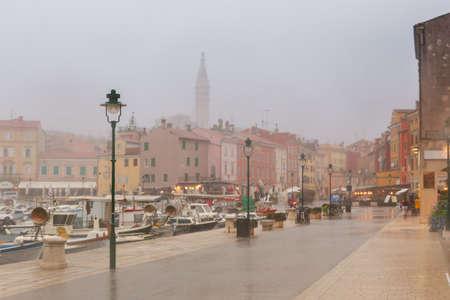muggy: Rany day in old town Rovinj-Croatia