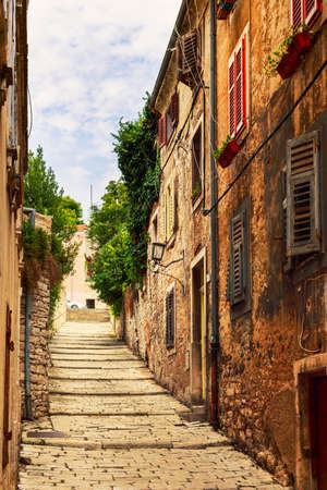 roman blind: Cozy and narrow streets in Pulas medieval old town, Croatia