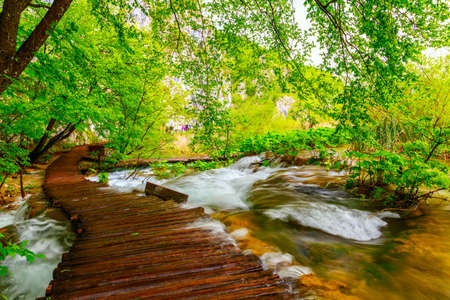 river view: Wooden path in National Park in Plitvice in Croatia Stock Photo