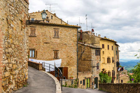 europe vintage: Beautiful view of old traditional houses and idyllic alleyway in the historic town of Volterra, province of Pisa, Tuscany, Italy