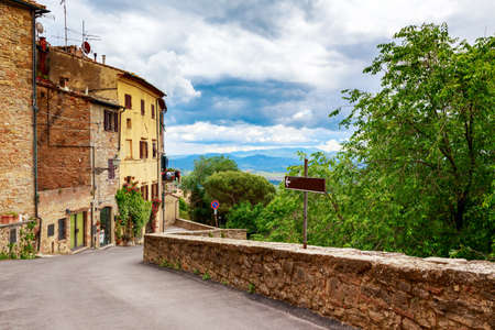 volterra: Beautiful view of old traditional houses and idyllic alleyway in the historic town of Volterra, province of Pisa, Tuscany, Italy