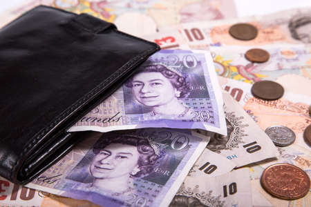 Pound money and black wallet background