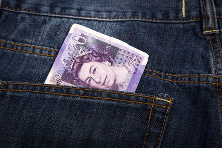 sterlina: Sterling currency money in the pocket of jeans Archivio Fotografico