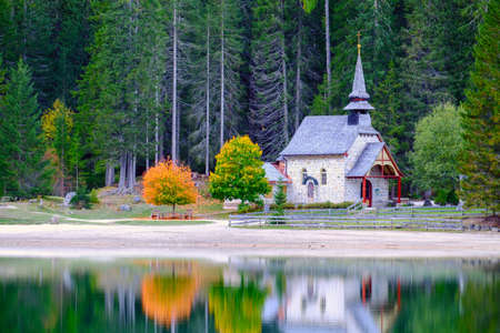 Little chapel at the Braies Lake ( Pragser Wildsee ) in Dolomites mountains, Sudtirol, Italy