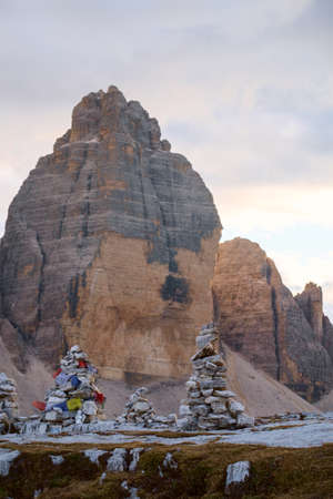 cairn: Small rock cairn in Dolomites alps mountains at background