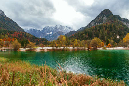 Autumn scenery at lake Jasna, mountain lake  in north Slovenia in the Julian Alps.