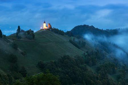 karavanke: St. Primoz church on the hill at sunset at Jamnik, Slovenia Stock Photo
