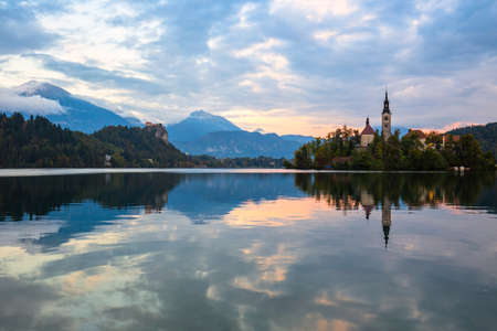 Lake Bled with St. Marys Church of the Assumption on the small island; Bled, Slovenia, Europe. Stock Photo