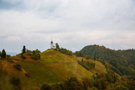 primus: St. Primoz church on the hill at sunset at Jamnik, Slovenia Stock Photo