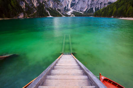 sudtirol: Boats on the Braies Lake ( Pragser Wildsee ) in Dolomites mountains, Sudtirol, Italy
