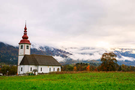 slovenian: Typical slovenian church in the mountains, near Bohinj lake. Slovenia Stock Photo