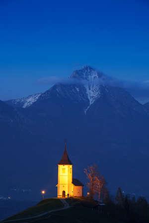 karavanke: Lonely church on the hill at sunset at Jamnik, Slovenia