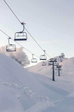 Charmant Ski Lift Chairs And Blue Sky Near Vogel Ski Center Slovenia Stock Photo    94120012