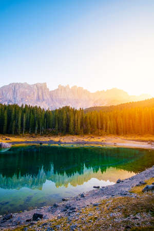 Carezza lake( (Lago di Carezza) ) and Mount Latemar in Dolomites Alps . Italy