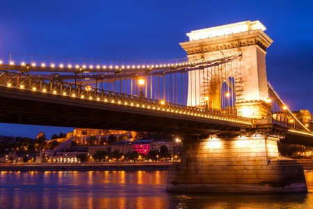 Szechenyi Chain Bridge ( Szechenyi Lanchid) by night in the city of Budapest, Hungary.