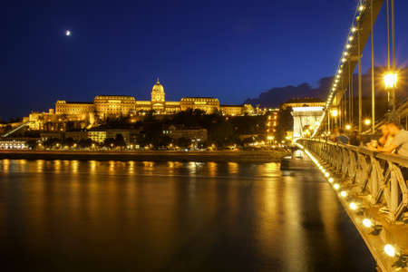 Chain Bridge (Lanchid) and Royal palace at night in Budapest, Hungary
