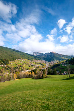 Alpine village of Ortisei with blue sky in Dolomites, South Tyrol, Italy Stock Photo