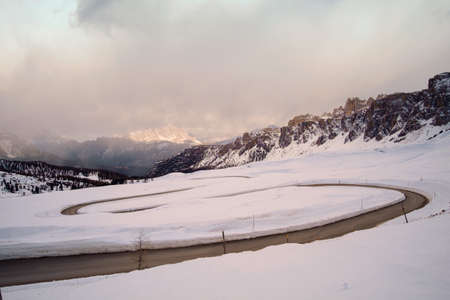 Snowy mountain road in winter landscape near Passo Giau in Dolomites mountain in Italy.