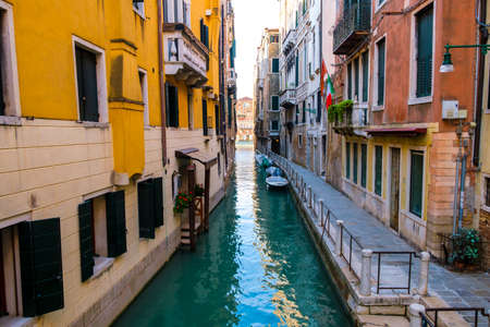 Typical Venice narrow water canal and old traditional colorful buildings. Italy, Europe. Stock Photo