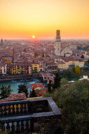View of Verona city with Ponte Pietra and the river Adige at sunset.Italy. Stock Photo