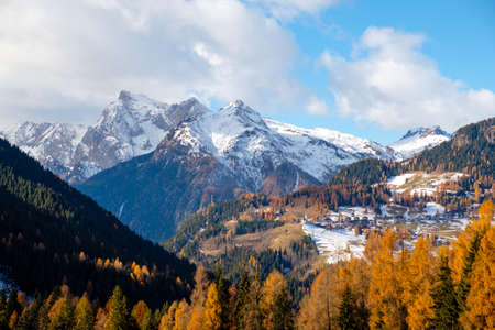 Mountainous landscape with villages of Colle Santa Lucia at the Dolomites in Italy