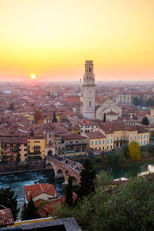 View of Verona city with Ponte Pietra and the river Adige at sunset.Italy. Editorial