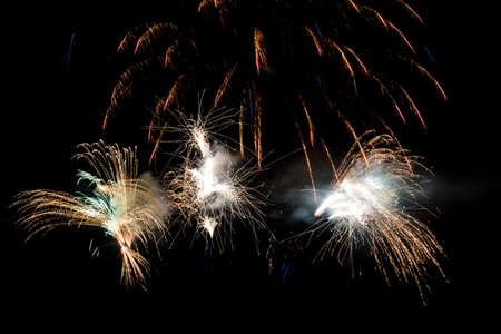 Festive celebration firework lights in the dark night sky