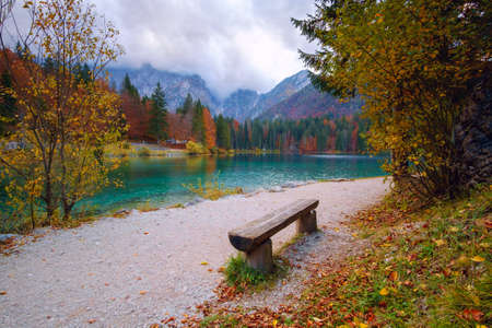 Autumn scenery at lake Fusine - Lago di Fusine-mountain lake in north Italy in the Alps. Stok Fotoğraf