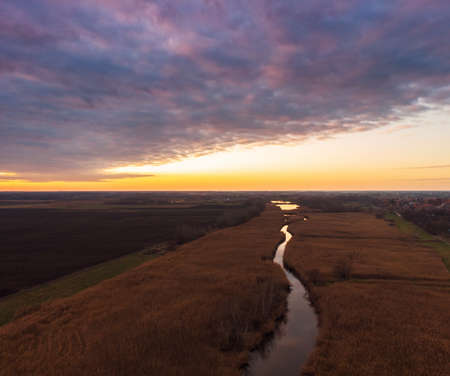 Aerial view of sunset river. Drone flying over the river Tisza in Hungary Standard-Bild