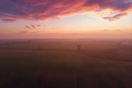 Aerial view from the drone, flight above autumn landscape fields and meadow and fantastic sunset in Hungary