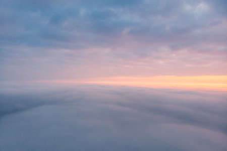 Drone fly above  cloudy sunset sky, view over white fluffy clouds