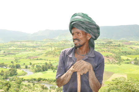 Ethiopian farmer with beautiful background
