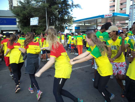 Participants of the Great Ethiopian Run,2016 edition, in a group dancing Editorial