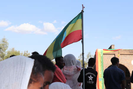 January 19, 2019: a group of unidentified people with a flag dressed in traditional attire during the Timkat holiday, the important Ethiopian Orthodox celebration of Epiphany Editorial