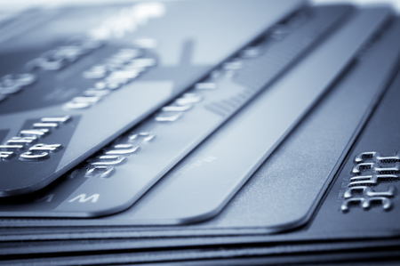 mastercard: Credit card -financial background. Blue toned image Stock Photo