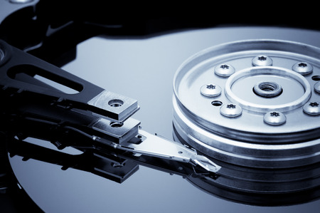 databank: Open hard disk detail. Blue toned image