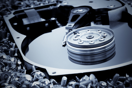 databank: Hard disk detail on bolts background. Blue toned image Stock Photo